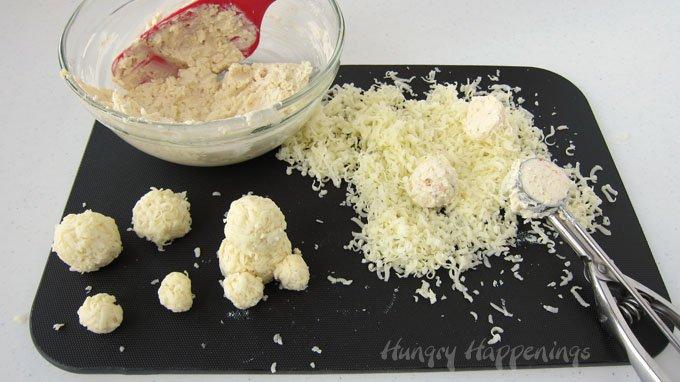 Turn mini cheese balls into adorably cute Cheesy Snowgie Snacks.