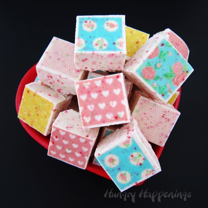 Add beautiful designs to the top of white chocolate fudge by using Sugar Stamps. See how at HungryHappenings.com.