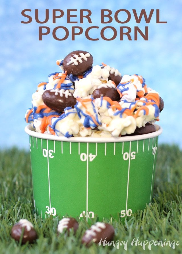 Snack on some Super Bowl Popcorn with Chocolate Almond Footballs while cheering on your favorite team. Make and decorate your white chocolate popcorn with white drizzles of orange and blue if you are cheering for the Broncos or with black, blue, and silver if you want the Panthers to win. Get the recipe at HungryHappenings.com.