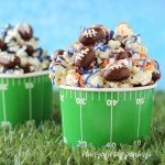Snack on some Super Bowl Popcorn with Chocolate Almond Footballs while cheering on your favorite team. Make and decorate your white chocolate popcorn with white drizzles of orange and blue if you are cheering for the Broncos or with black, blue, and silver if you want the Panthers to win.