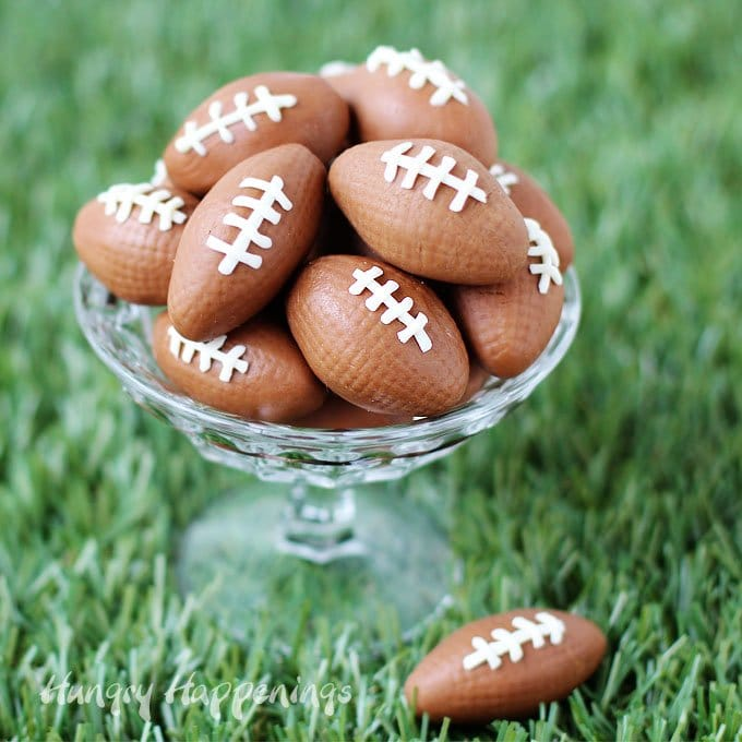 Make 2 ingredient Chocolate Caramel Fudge then use it to make these fun fudge footballs with white chocolate laces. See how at HungryHappenings.com.