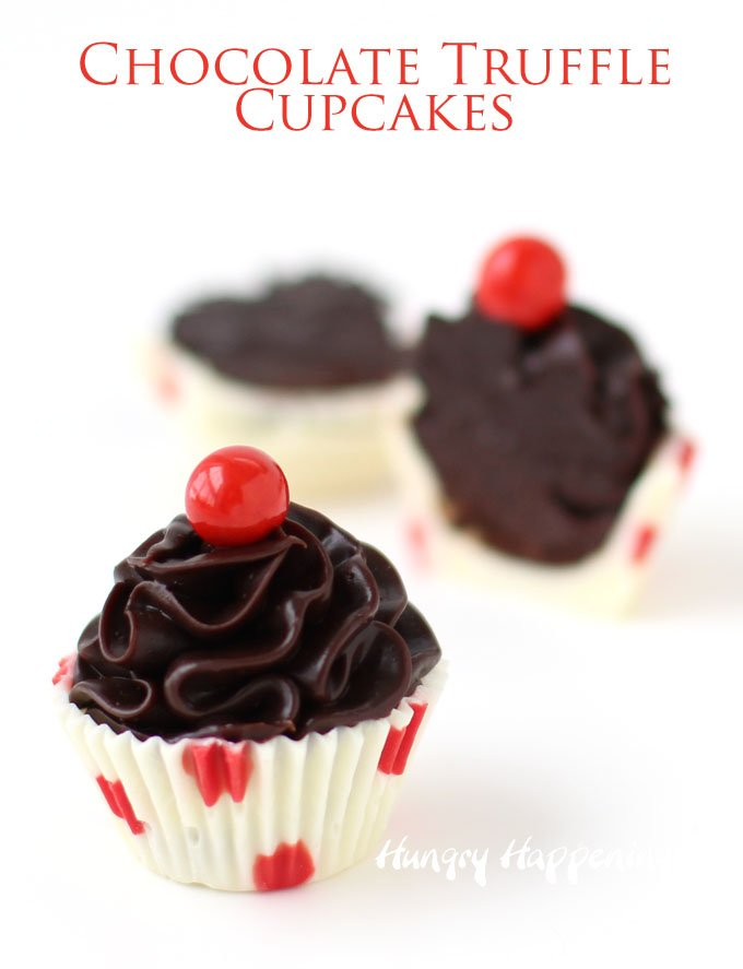 Cute little chocolate truffle cupcakes make sweet Valentine's Day treats. Each polka dot white chocolate cup is filled with a swirl of dark chocolate ganache and topped with a Sixlet. See how easy they are to make at HungryHappenings.com.