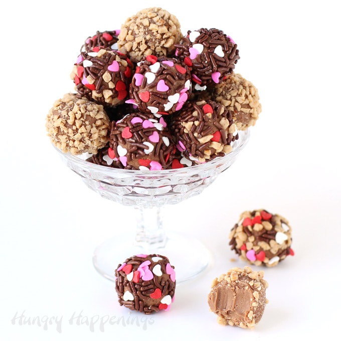 Homemade salted caramel truffles made with milk chocolate and salted caramel ice cream rolled in crushed toffee and heart sprinkles.