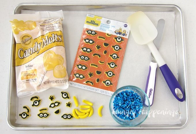 Ingredients needed to make bright yellow Minion Bark include Yellow Candy Melts, Minion Icing Decorations, Banana Fruit Runts, and blue sprinkles.