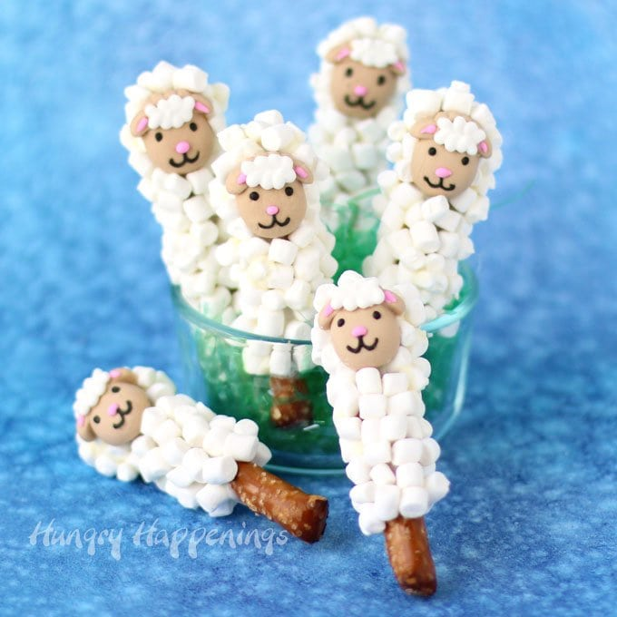 Dip pretzel rod halves in white chocolate then coat with marshmallows to create these sweet little Lamb Pretzel Pops. See how easy they are to make at HungryHappenings.com.