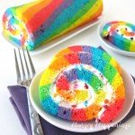 Brightly colored Rainbow Cake Roll filled with Rainbow Chip Frosting makes a festive dessert for St. Patrick's Day, Easter, or a birthday.