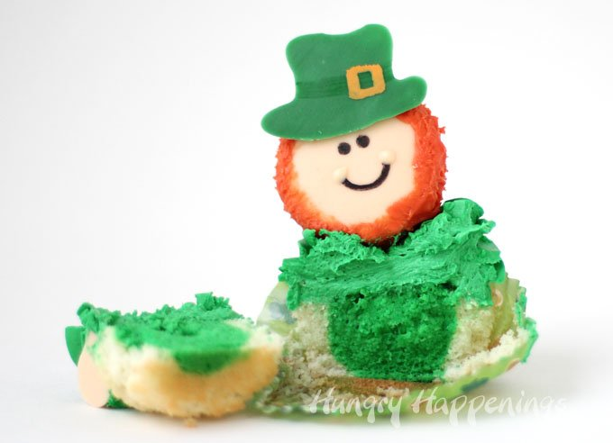 See the surprise color hiding inside these cute St. Patrick's Day Leprechaun Cupcakes.
