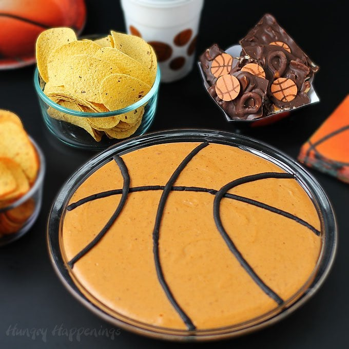 During March Madness, serve some fun Basketball Party Snacks including a Basketball Bean Dip and Crunchy Chocolate Bark topped with Basketball Candies.