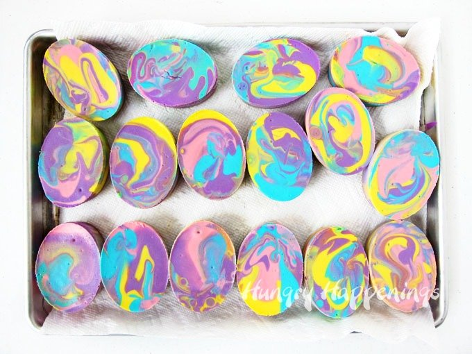 Brighten up the holiday by serving a fun Easter dessert. These Tie-Dye Swirl Cheesecake Easter Eggs are sure to delight.