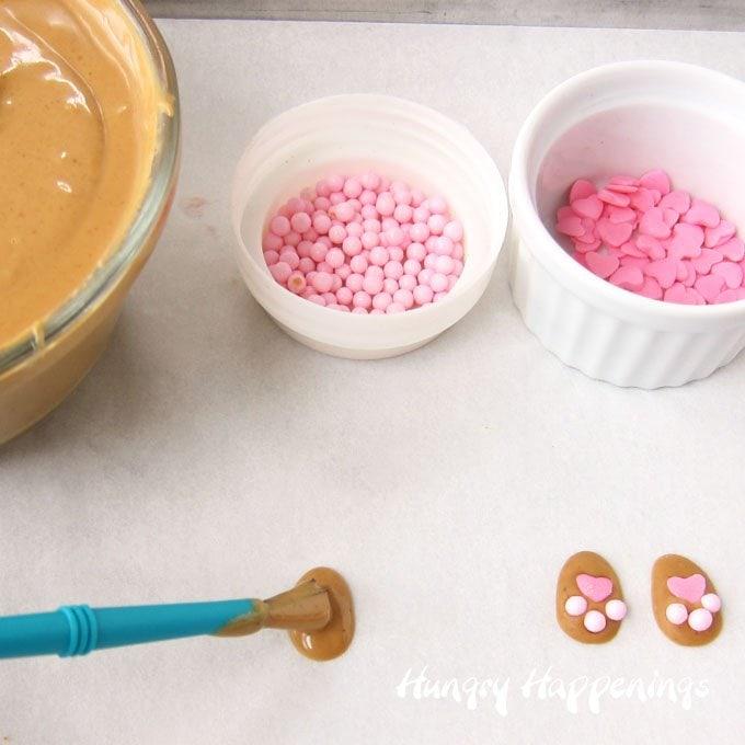 Make peanut butter candy bunny feet to attach to bunny butt pretzels.
