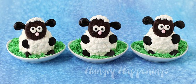 Could these Fluffy Sheep Cupcakes be any cuter with their roly poly cupcake bodies covered in fluffy white frosting fur and a Peppermint Patty head?