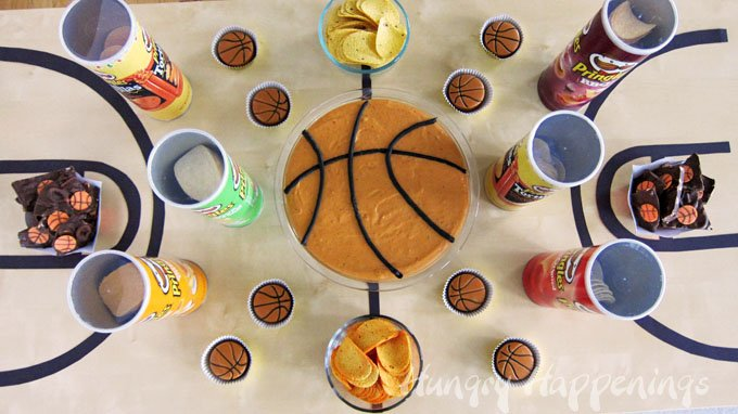 Fun Basketball party ideas - set your table to look like a basketball court topped with your favorite snacks.