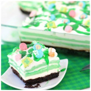 Layers of creme de menthe pudding, cream cheese fluff, and whipped cream are drizzles with Creme de Menthe and chocolate syrup.