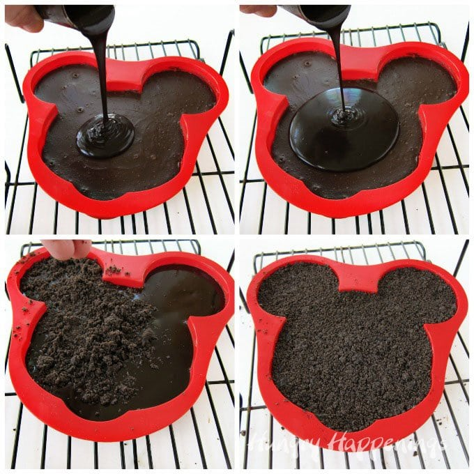 Pour chocolate ganache over a chocolate cheesecake Mickey Mouse then add an Oreo Cookie crust on top.