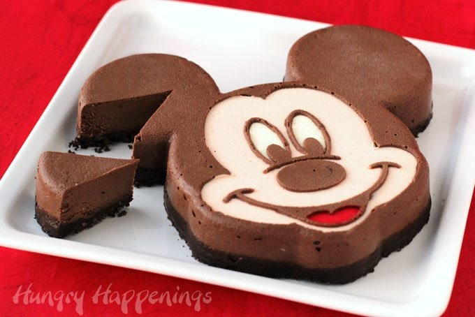 Lusciously creamy chocolate Mickey Mouse Cheesecake with a double chocolate crust. See the recipe at HungryHappenings.com.