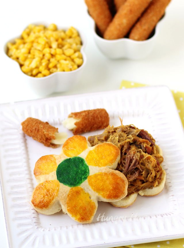 Serve daisy shaped and decorated biscuits filled with Farm Rick Smokehouse BBQ in Carolina Style Mustard Sauce for Mother's Day. This pretty meal is sure to impress any mom.
