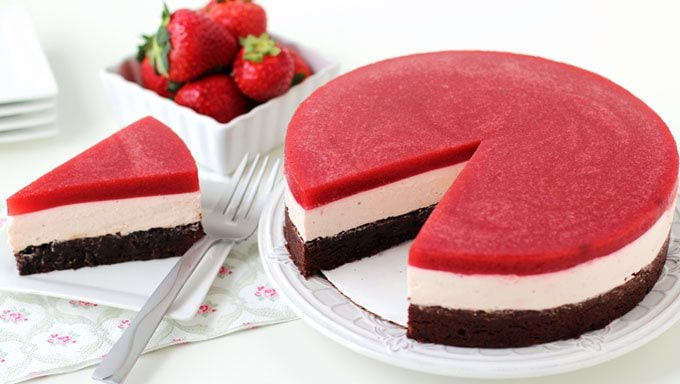 Chocolate brownie topped with light and fluffy strawberry cheesecake mousse and a refreshing strawberry gelée.