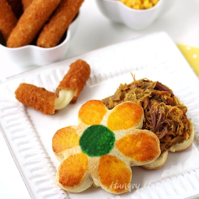 Serve Pretty Pulled Pork Sandwiches on Daisy Biscuits for any special occasion like Mother's Day. It's easy to dress up BBQ by serving it on a flower shaped biscuit.