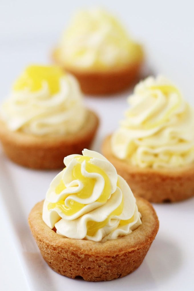 Triple Lemon Cookie Cups filled with lemon cheesecake mousse and topped with lemon curd.