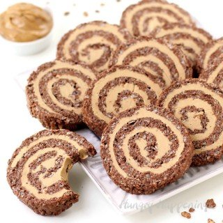 Turn ordinary rice krispie treats into festive Cocoa Crispy Treat Peanut Butter Fudge Pinwheels. Chocolate cereal treats are flattened and filled with peanut butter fudge then are rolled up and cut into pretty swirled pinwheels.