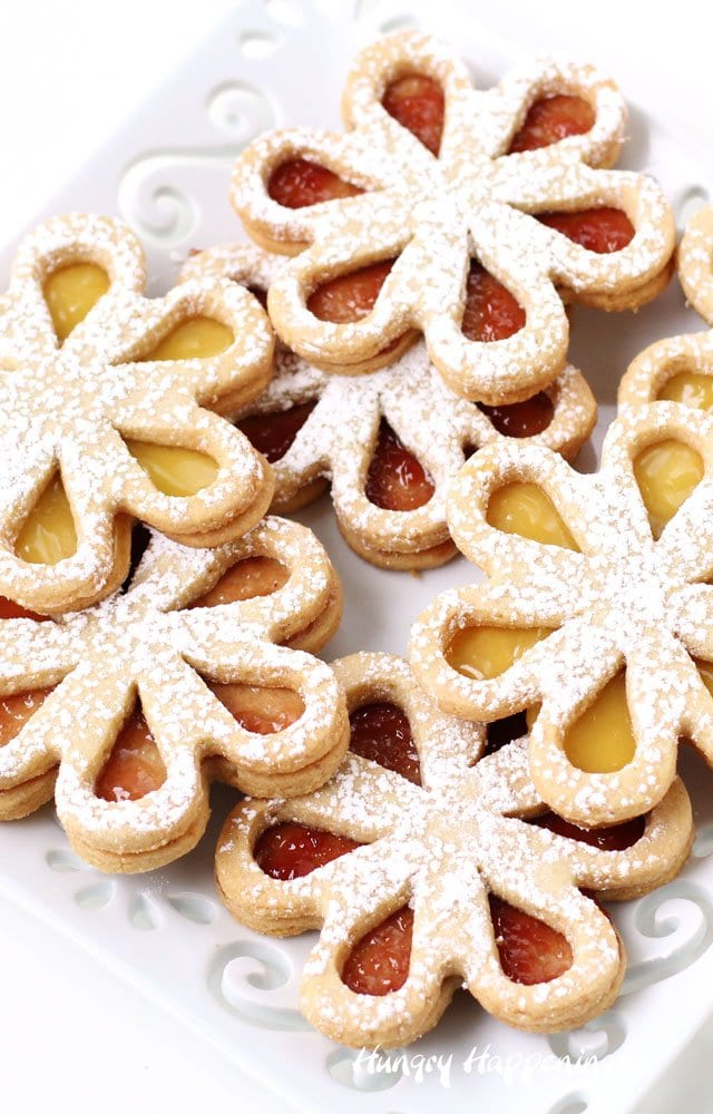 Fill these pretty Linzer Cookie Daisies with raspberry preserves or lemon curd to make them colorful and bright. These daisy cookies make perfect treats for a Mother's Day party, a bridal shower, an afternoon tea, or ladies luncheon.
