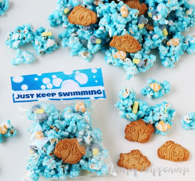 Finding Dory Just Keep Swimming Popcorn. Blue candy coated popcorn filled with tiny Dory and Nemo marshmallows and cookies.