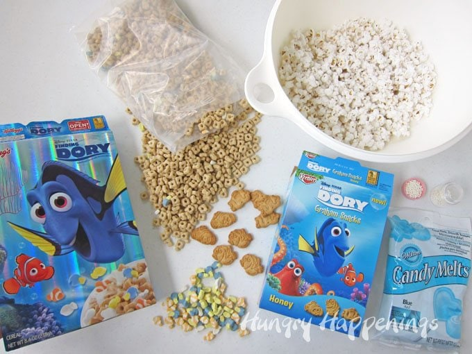 Make Just Keep Swimming Popcorn using marshmallows from Finding Dory Cereal and Finding Dory Graham Snacks.