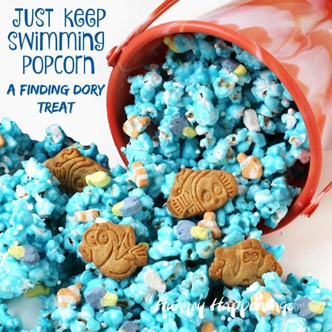 Just Keep Swimming Popcorn - A Finding Dory Treat. White chocolate popcorn sprinkled with Dory and Nemo marshmallows and cookies.
