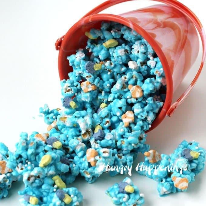 Ocean blue white chocolate popcorn filled with tiny marshmallow fish.