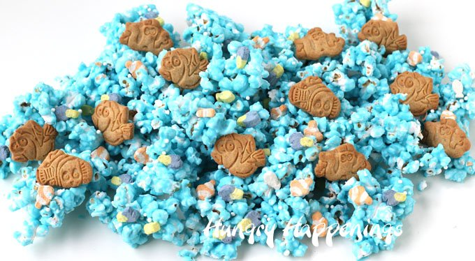 Blue colored white chocolate popcorn speckled with Dory and Nemo marshmallows and cookies.