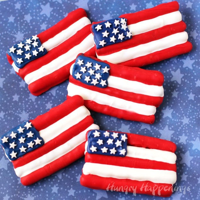 Make your 4th of July a little sweeter by serving some Red, White and Blue Pretzel Flags. These salty and sweet treats are perfect for any patriotic party.