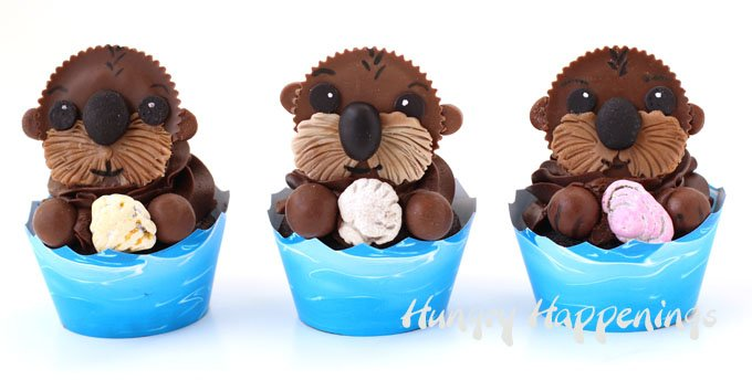 3 cute sea otter cupcakes wrapped with ocean wave cupcake wrappers