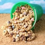 Beach Pail Popcorn - Peanut Butter White Chocolate Popcorn Sprinkled with Sandy Cookie Crumbs and Chocolate Sea Shells