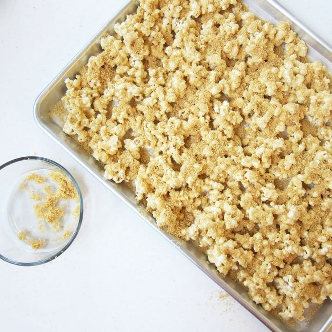 Peanut Butter Popcorn Sprinkled with Cookie Crumbs can be used to make Beach Pail Popcorn that looks like a sandy beach.