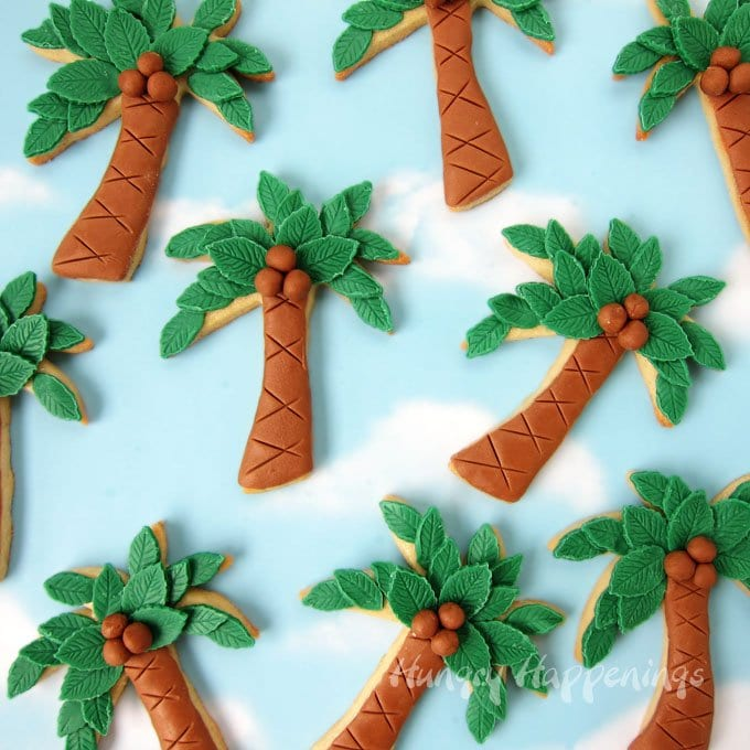 Decorate Palm Tree Cookies using modeling chocolate to give them texture including 3 dimensional coconuts.