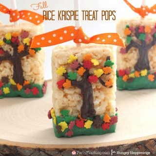 When the leaves start falling outside, head inside to make a batch of these festive Fall Tree Rice Krispie Treats.You'll have an entire forest created before you know it. Fall treats, kids snacks, fall desserts, autumn leaf sprinkles.