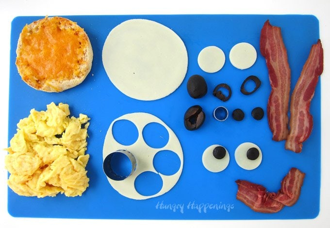 Make an open-faced egg sandwich into an actual face to make a back to school breakfast more fun.