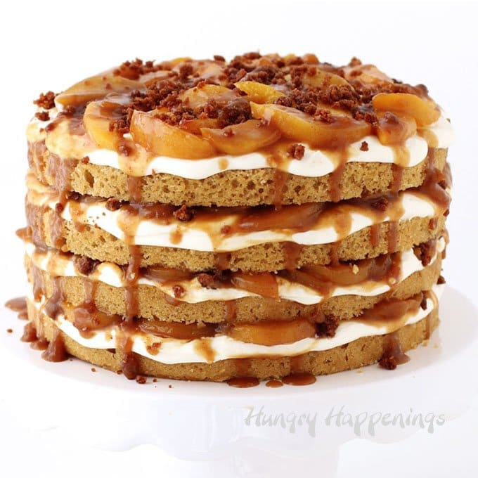 Naked peach cobbler cake layered with cream cheese frosting and caramelized peaches.