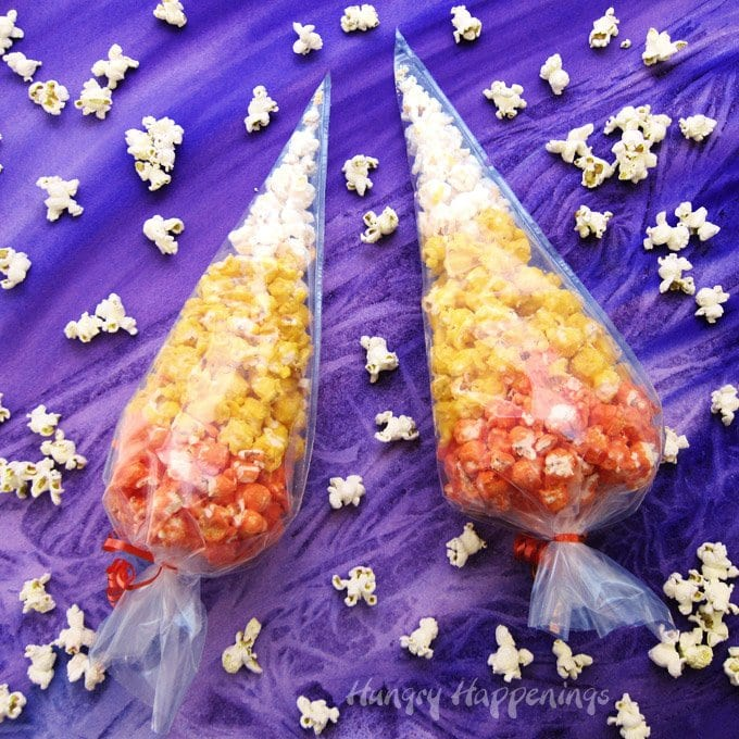 Dress up your popcorn to look like an iconic Halloween candy. Toss some popcorn in orange, yellow, and white Candy Melts and nestle the pieces in clear plastic cone shaped bags to create these festive Popcorn Candy Corn Bags.