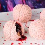 Creep out your friends and family this Halloween by serving them Bleeding PB&J Brains. They may look a bit gross but they are tasty peanut butter fudge and jelly filled candy brains.
