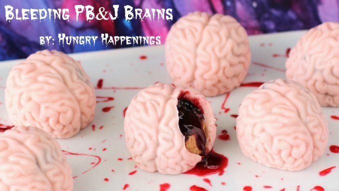 Candy brains filled with peanut butter fudge and oozing raspberry sauce blood.