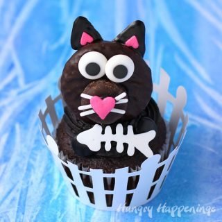 Use Peppermint Patties to make these cute Black Cat Cupcakes for Halloween or to give to your favorite cat lover.