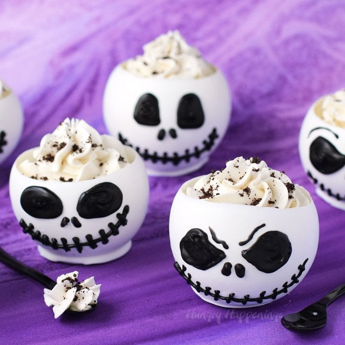 these jack skellington chocolate bowls filled with cookies n cream cheesecake mousse are to die - Christmas Party Desserts