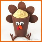 milk chocolate turkey candy cup filled with pumpkin mousse