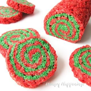 Celebrate the holiday season with some festive Red and Green Rice Krispies Treat Christmas Pinwheels. Layers of colorful marshmallow cereal treats are rolled up and cut to reveal pretty swirls of holiday color.