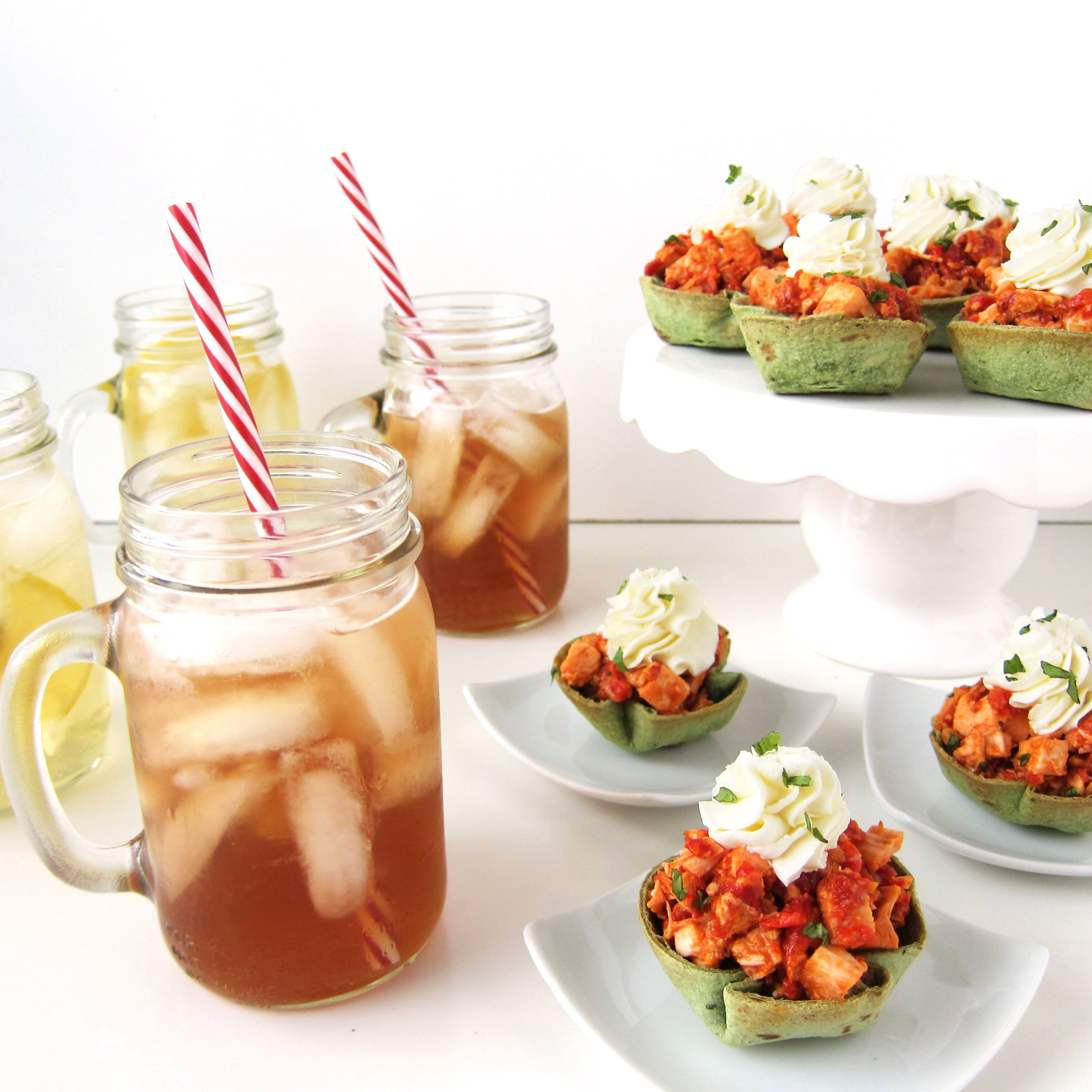 Festive little baked spinach tortilla cups filled with a brightly flavored Roasted Red Pepper Pesto Chicken Salad pair perfectly with Lipton Iced Tea and will make a lovely meal to bring your family together during the busy holiday season.