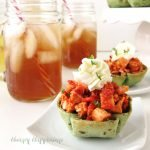 Festive little baked spinach tortilla cups filled with a brightly flavored Roasted Red Pepper Pesto Chicken Salad pair perfectly with Lipton Iced Tea and will make a lovely meal during the busy holiday season or anytime.