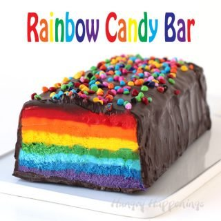 Cut into this chocolate covered nougat bar to reveal brilliantly colored layers of red, orange, yellow, green, blue, indigo, and purple. This Giant Rainbow Candy Bar will brighten anyone's day.