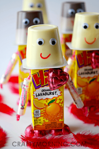 Super Cute Valentine's Day Robots made with juice boxes, pudding, and candy are perfect for classroom treats