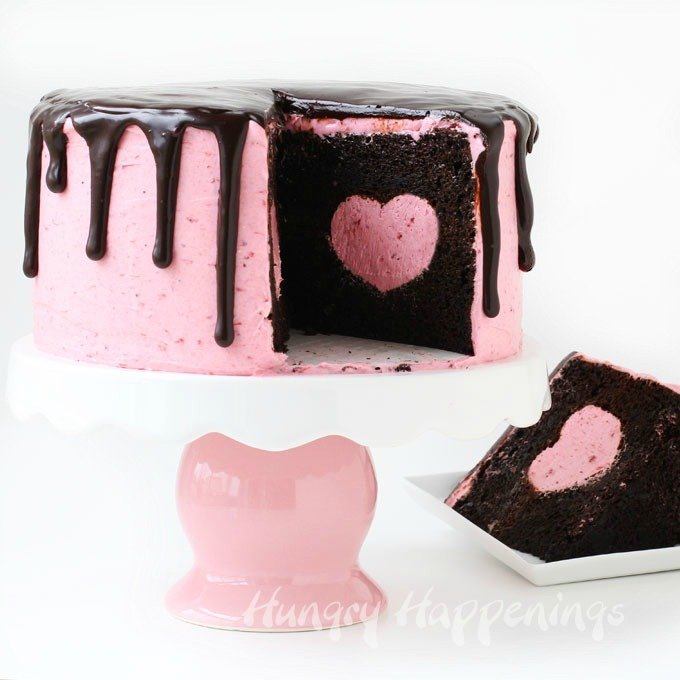Cut into this pretty pink cake to reveal a strawberry cheesecake heart hiding inside a rich and decadent chocolate cake. This Strawberry Cheesecake Heart Surprise Cake will make Valentine's Day even more sweet!